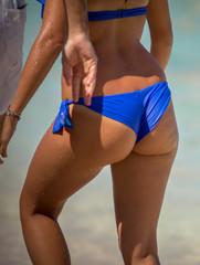 Attractive young woman in bikini on the beach