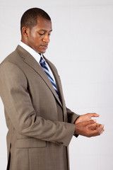 businessman holding his hands out, palm open