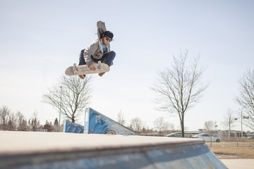 Young skateboard enthusiast in skatepark