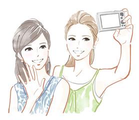 写真をとる2人の女性