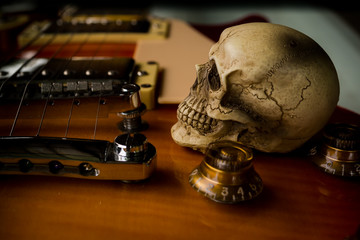 Skull and electric guitar