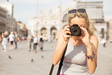 Tourist taking photos in Venice