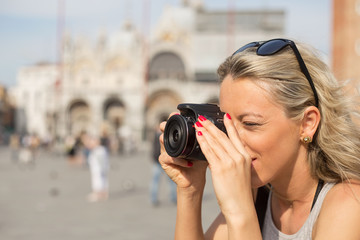 Girl taking photos with digital camera