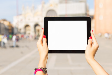 Tourist holding tablet computer with blank white screen