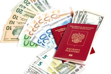 ,Российский паспорт и валюта на белом фоне.