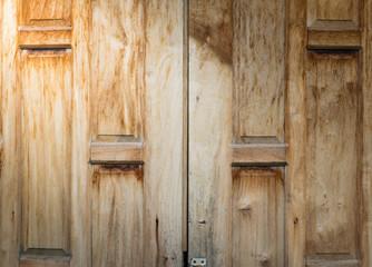 old wood door background texture with light from corner