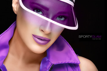 Sporty Beauty. Fashionable Young Woman in Purple Sun Visor