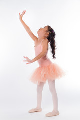 A little ballerina in the studio. On White Background