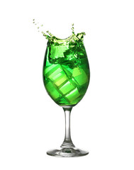 Green water spread in a wine glass isolated on white.