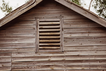 Closeup image of top of wooden house with vintage roof