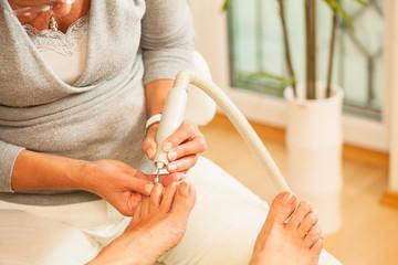 Woman having pedicure treatmenu