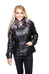 Young beautiful blond woman in a short black jacket with a fur collar