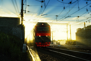 locomotive in the rays of the setting sun