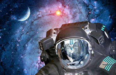 Astronaut spaceman alien extraterrestrial sci fi space invader planet. Elements of this image furnished by NASA.