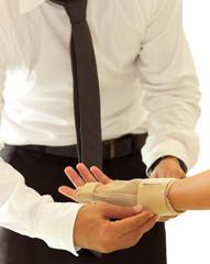 Doctor bandaging female broken hand