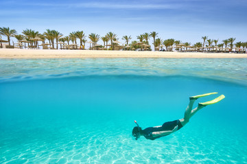 Young girl swims in the shallow bay, Marsa Alam Resort, Red Sea, Egypt
