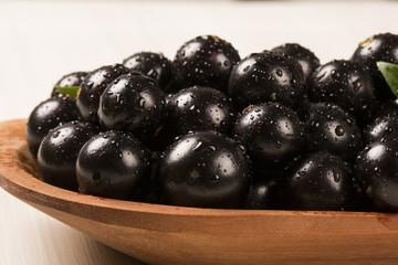 Berry Jaboticaba in bowl on white background