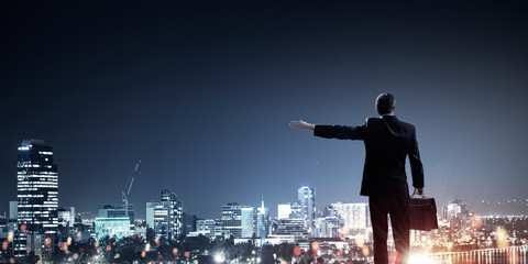 Businessman greeting his city