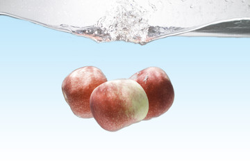 apples apples drop in the water  and air bubbles  Background presentations