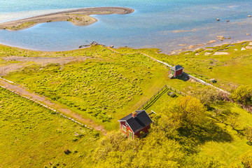 Typical small red Swedish house on the island of Oland