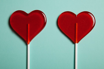 Two lollipops. Red hearts. Candy. Love concept. Valentine day.