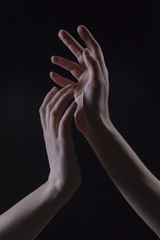Two hands in the dark