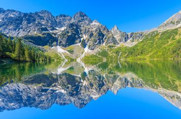 Fototapeta Reflection of mountain peaks in beautiful Morskie Oko lake, Tatra Mountains, Poland obraz