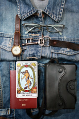 Overhead view of Blue Jeans and accessories ,meaning of The world (tarot card).