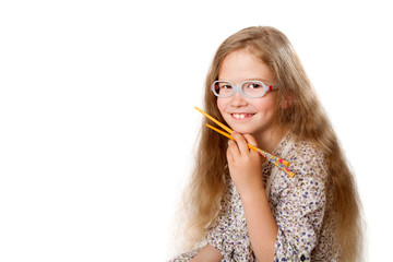 smiling girl holds japanese chopsticks, with space for text