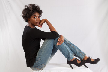 Pretty black woman sitting thoughtfully