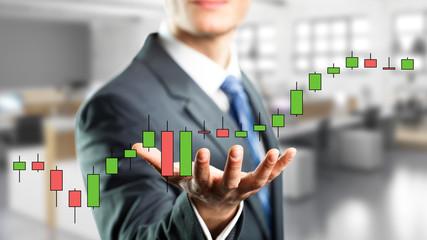 Geschäftsmann mit Aktienkurs