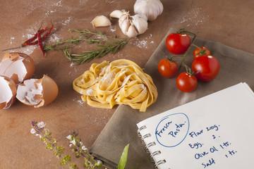 Pasta menu, Preparation of pasta recipe ingredients with empty notebook written fresh pasta recipe