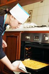 woman pulls cake
