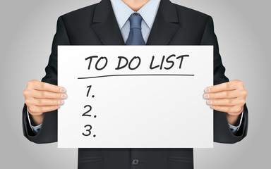 businessman holding to do list