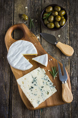 camembert and blue cheese  on cutting board
