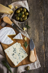 camembert and blue cheese  on wooden cutting board