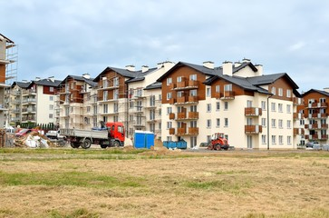 Construction site of residential buildings. Construction of a new block of flats.
