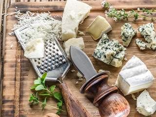 Different types of cheeses with nuts and herbs.