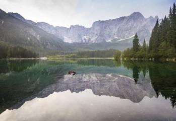 Aluminium Prints Reflection alpine mountain peaks reflecting in a mountain lake