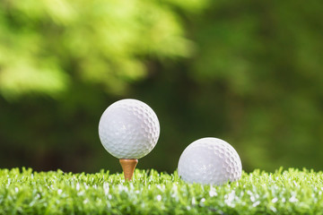 Golf ball on a tee peg and Golf ball on grass,
