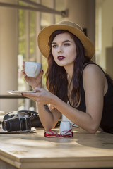 young beautiful traveler enjoying a coffee at street cafe