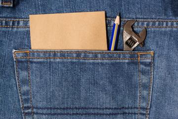wrench in  denim pocket