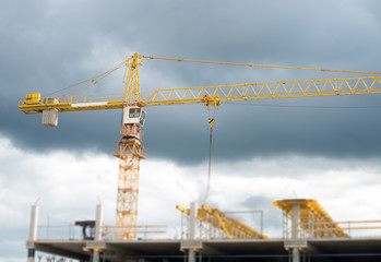 Working crane in the city. Construction site.