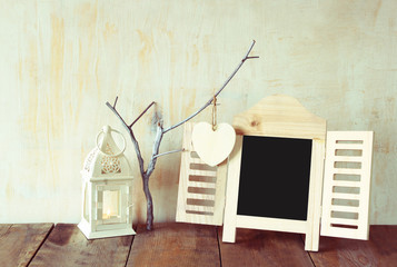decorative chalkboard frame and wooden hanging hearts