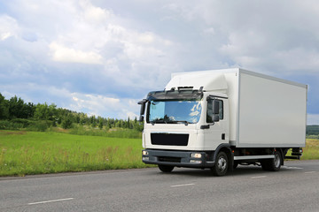 White Commercial Delivery Truck on the Road