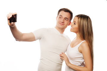 smiling couple with smartphone