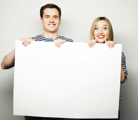 Couple holding a banner - isolated over a white background