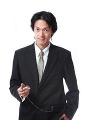 Businessman looking a pocket watch,attractive asian man on white