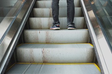 One standing on the escalator