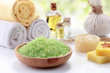 Essential oil and minerals salt, outdoor background